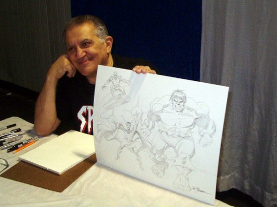 Sal Buscema  poses with a  Defenders  piece done for charity.