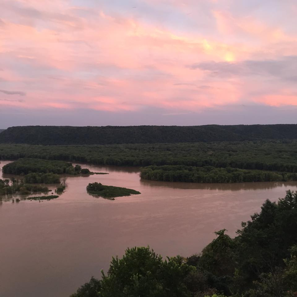 Mississippi River flooded. And glowing sunset.
