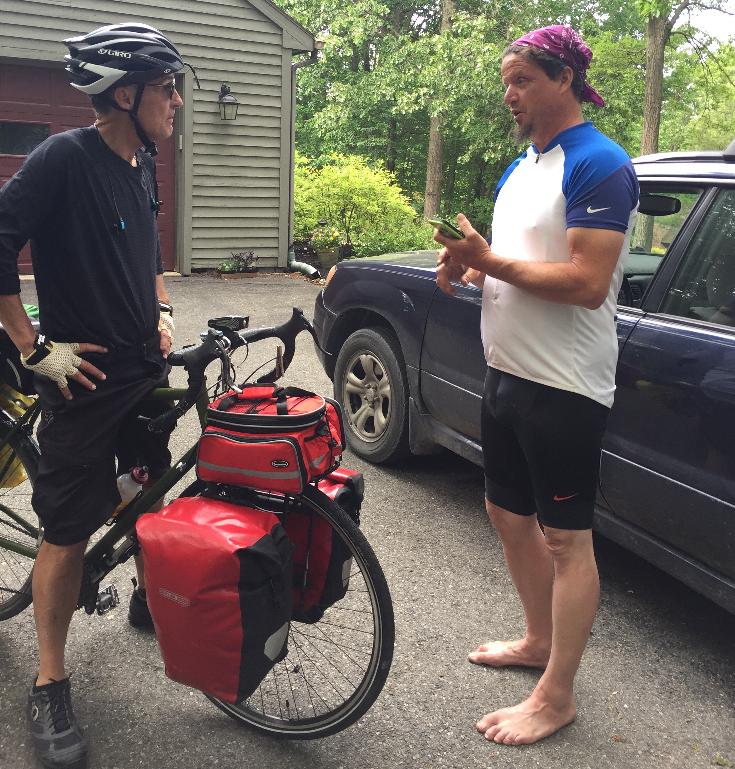 Dave and Shawn sharing biking stories. Dave assuring Shawn he WAS a knight in shining armor!