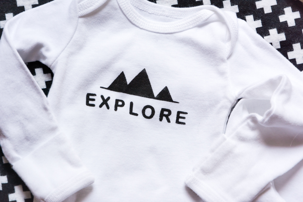 DIY Baby Onesie Using a Cricut Explore Air 2, Stencil Vinyl, Fabric Paint and New Designs by Paislee Press