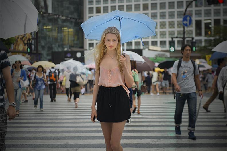 Emma Shibuya legs crossed.jpg