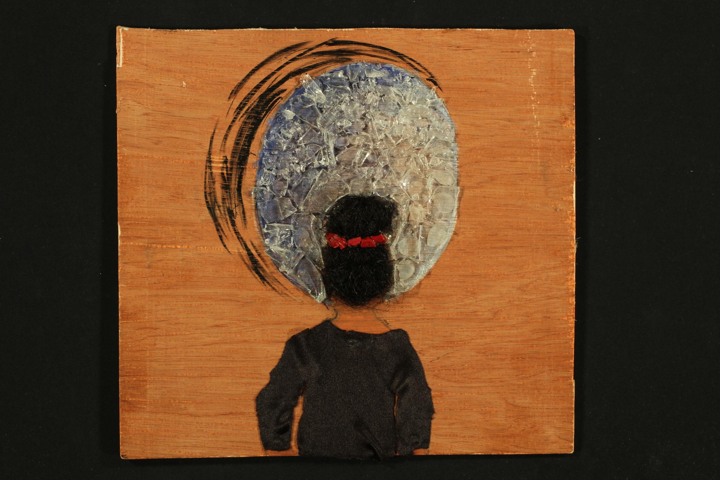 American Dreamin'  2014, wood, silk, acrylic, hair, broken glass, ink, 10in x 11in