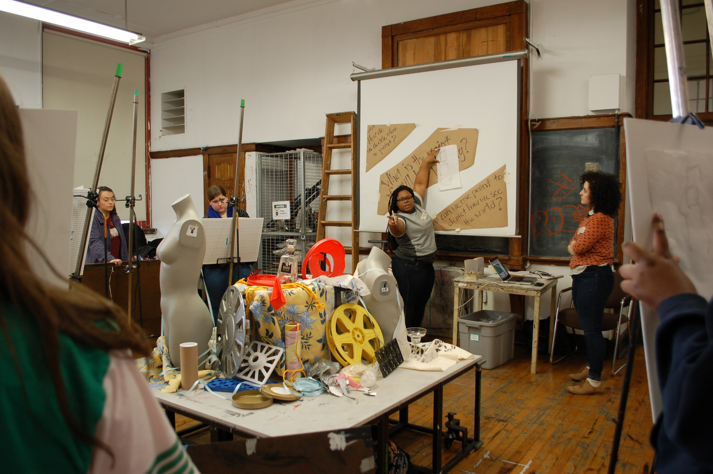 Here I am giving some info to my students on how to select parts of the still life for enlargement during the Saturday Studios High School Painting Course.