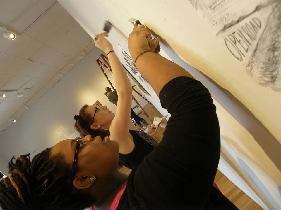 My freshman mentee and I prepping the gallery walls for the Fusion: Academic Compass Exhibit in the Brandt Gallery.