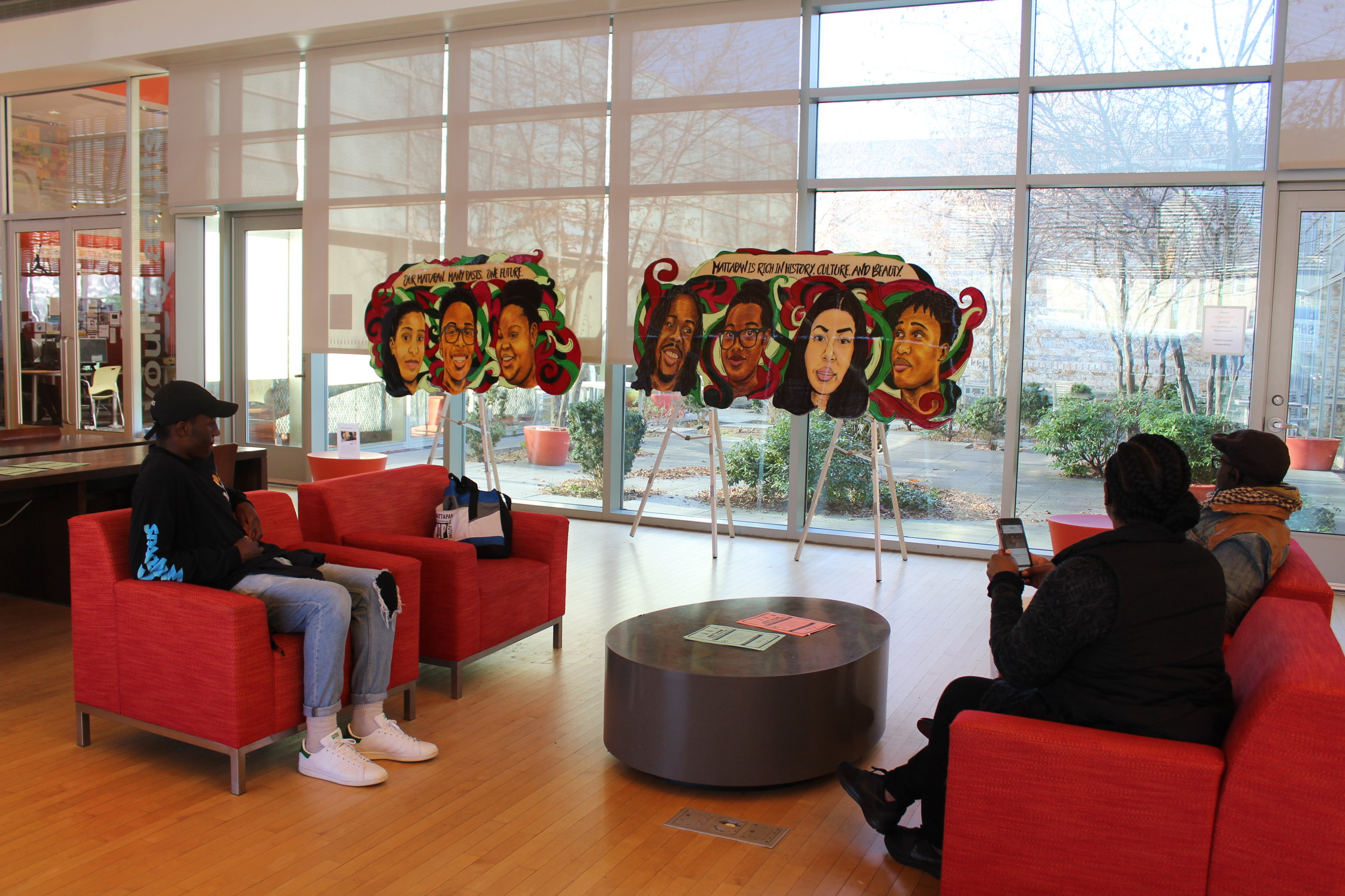 Faces of Mattapan, (2017, wood, acrylic, resin, 15ft x 4ft) on view at the Mattapan Library