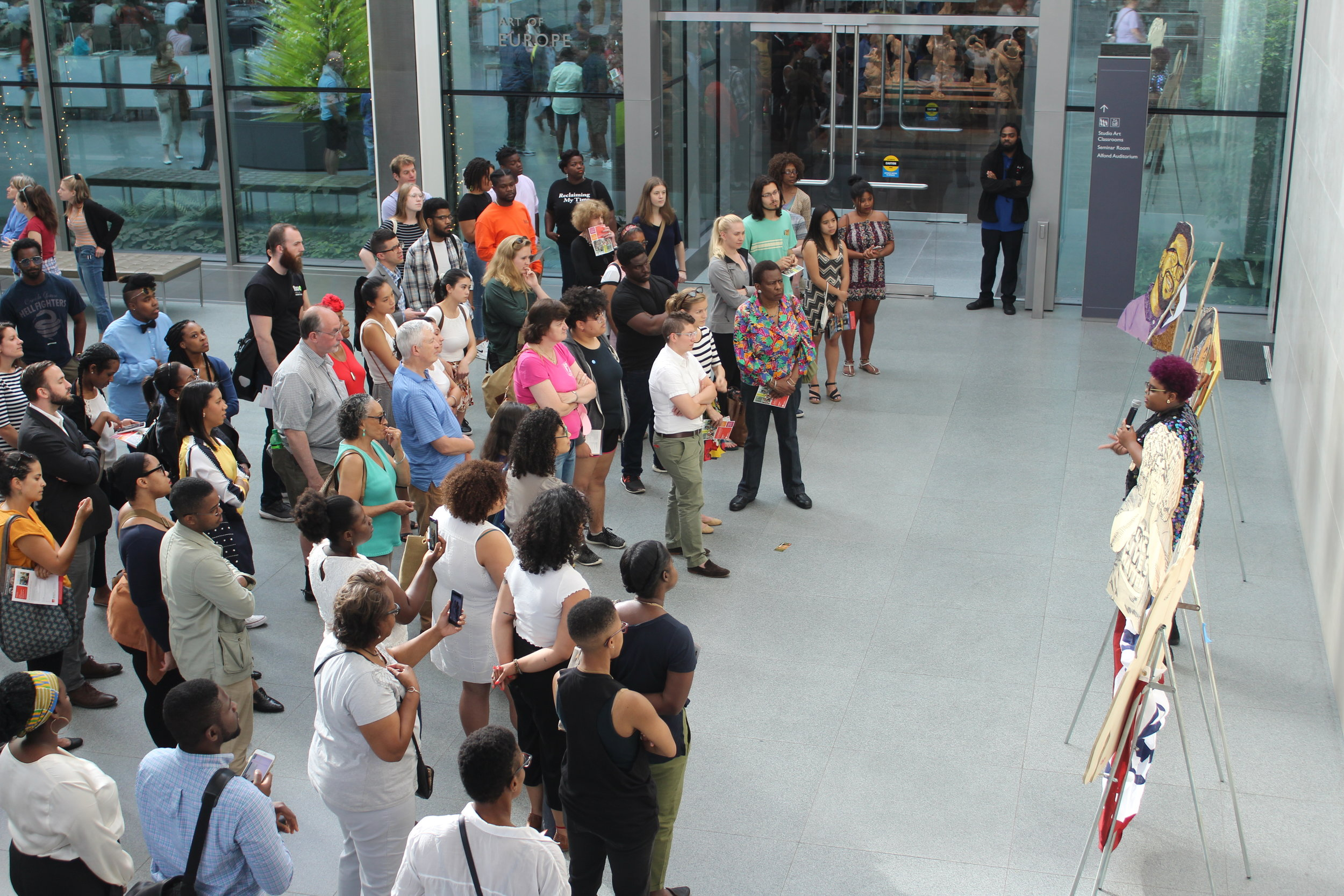 Engaging a crowd about my work during an artist talk at the Museum of Fine Arts.