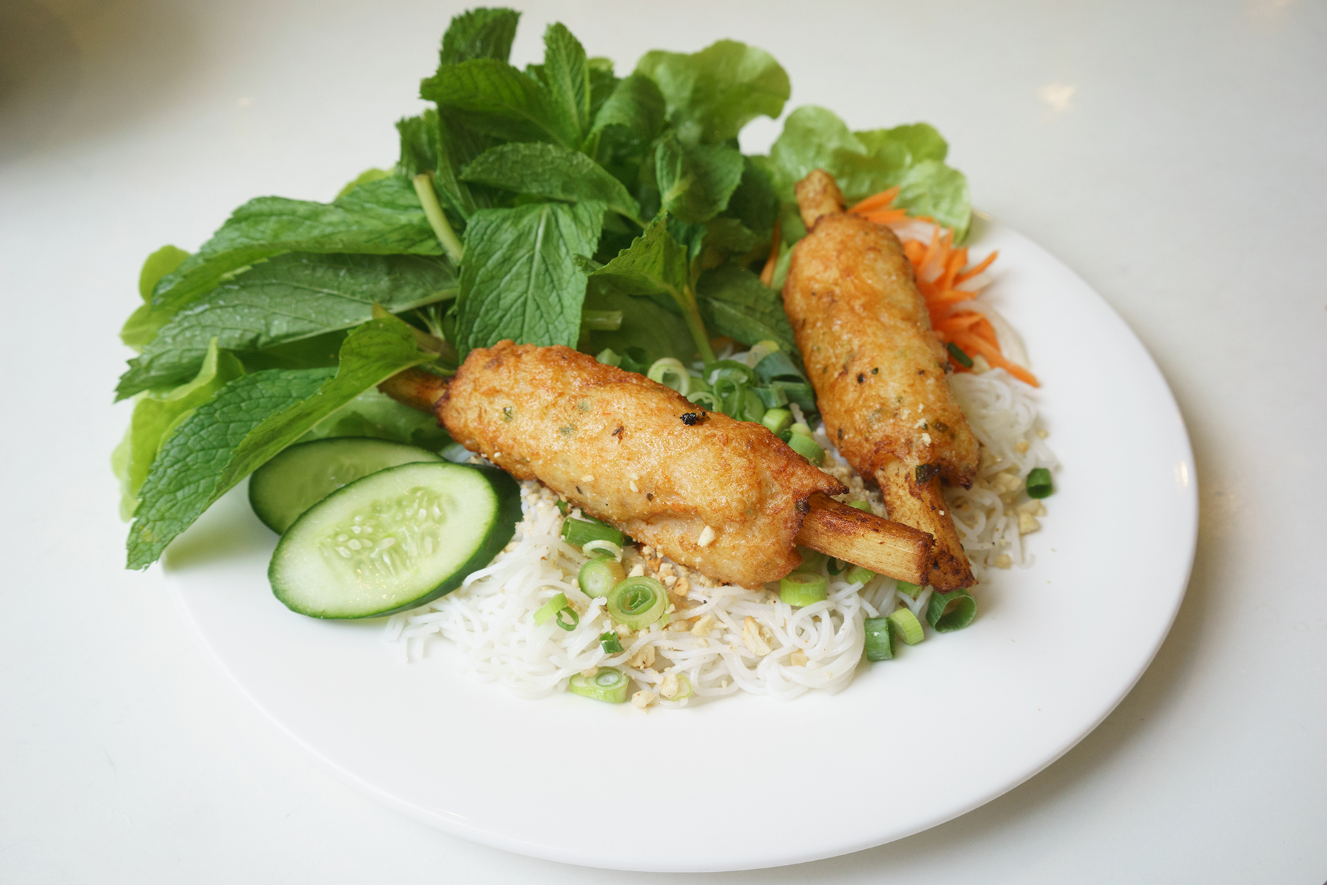 Sugar cane prawns with woven vermicelli ~ chao tom banh hoi