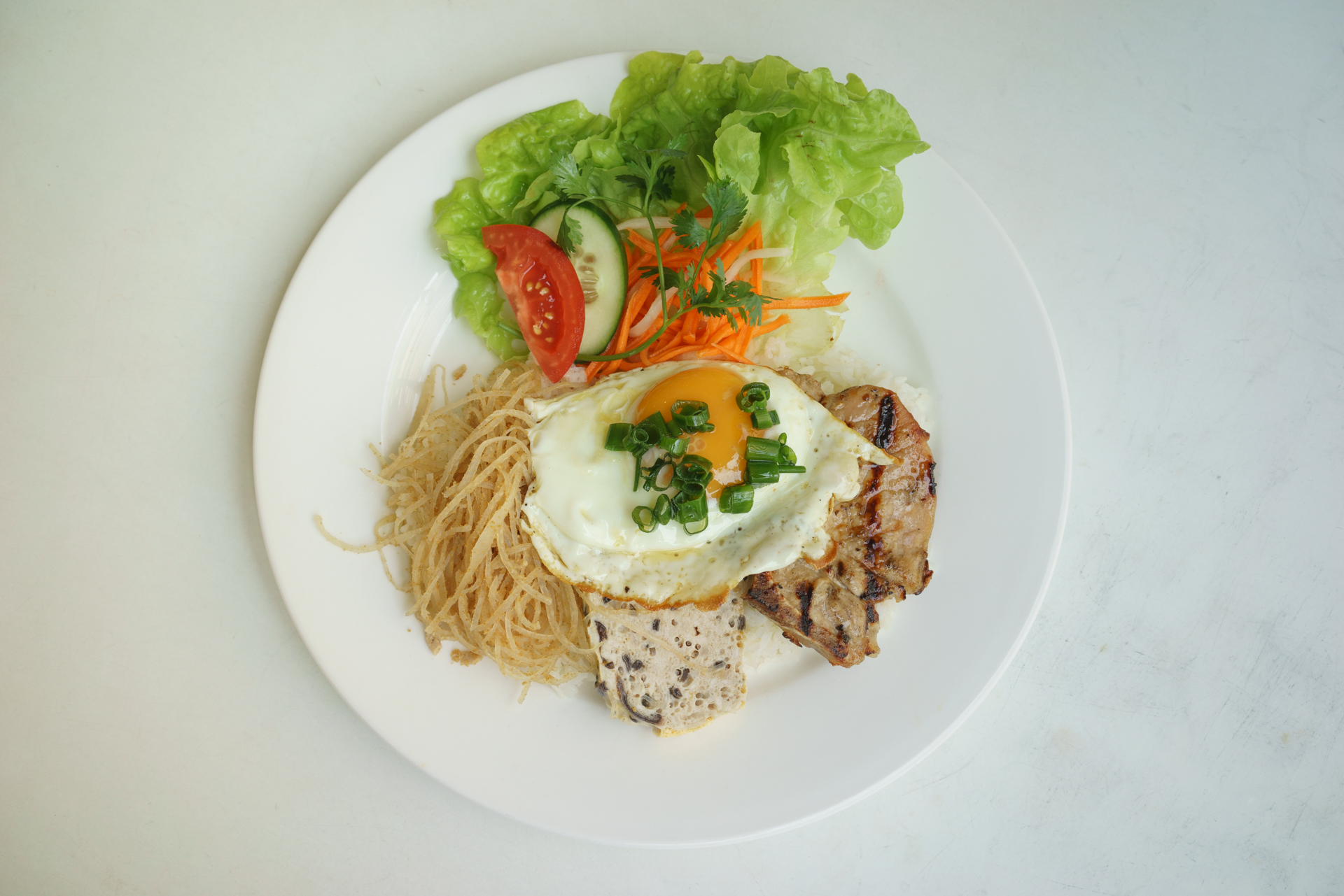 Combination broken rice with a fried egg ~ com tam bi suon cha trung