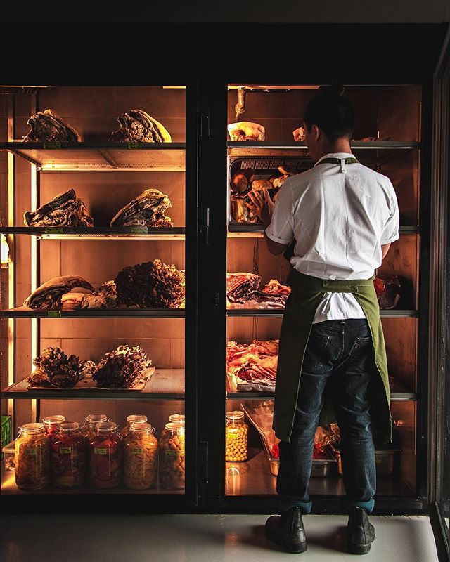 Sometimes I'm over at @amassrestaurant for meetings in the morning. Today I snapped a quick photo of the dry-aging locker as it was recently filled. Initially I shot it in isolation, very static, just how I like things. But then @illmaticsoul stepped in front to grab a quick photo, and it seemed like his presence would add something, a bit of humanity. So I snapped a frame or two. And that ended up being the shot. I guess what I'm getting at is, shoot what's in your head, but also be ready and open to other possibilities—sometimes they end up better than the initial plan. #amassrestaurant #copenhagen