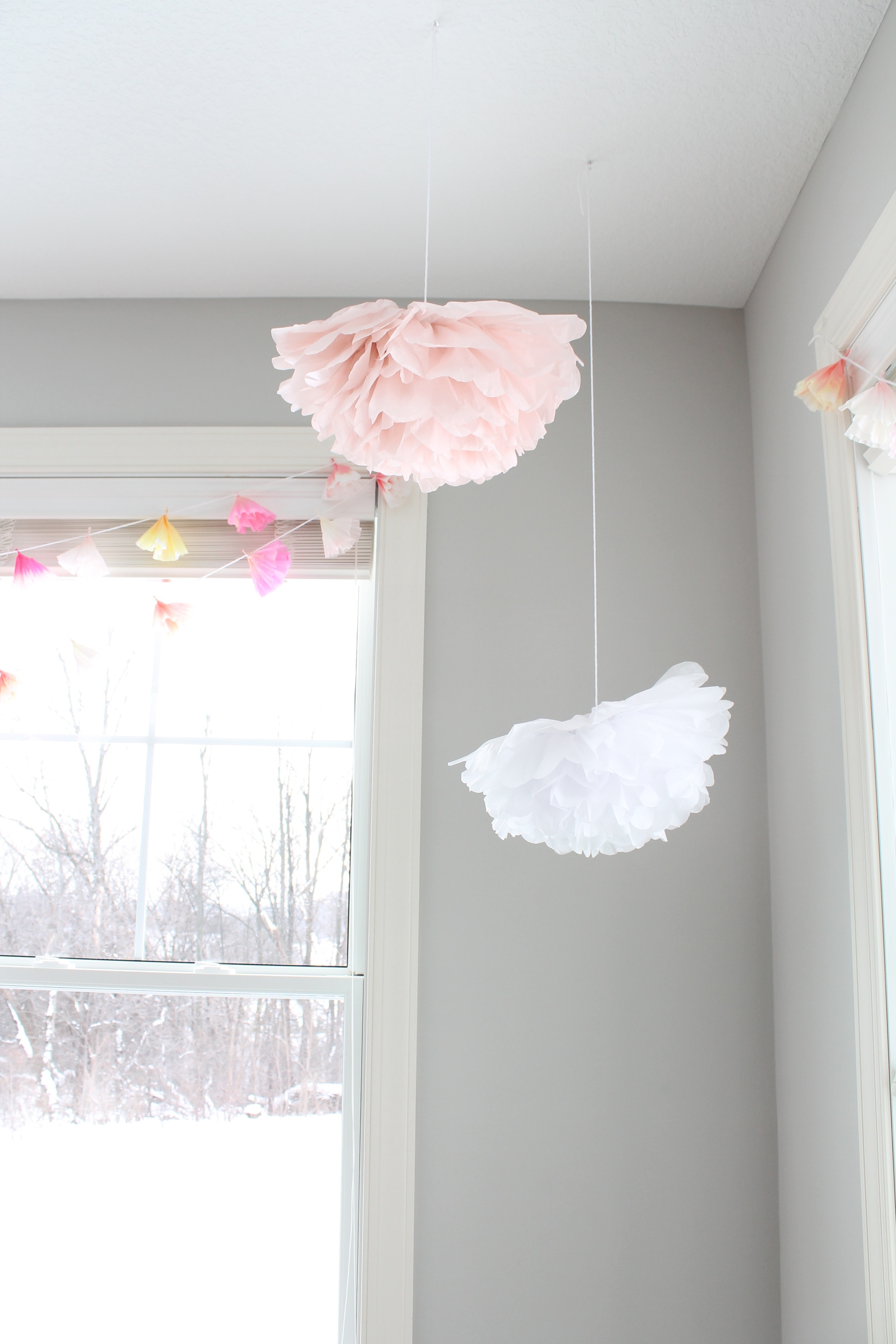 Giant tissue paper flowers are the perfect decoration fo a little girl's garden tea party.