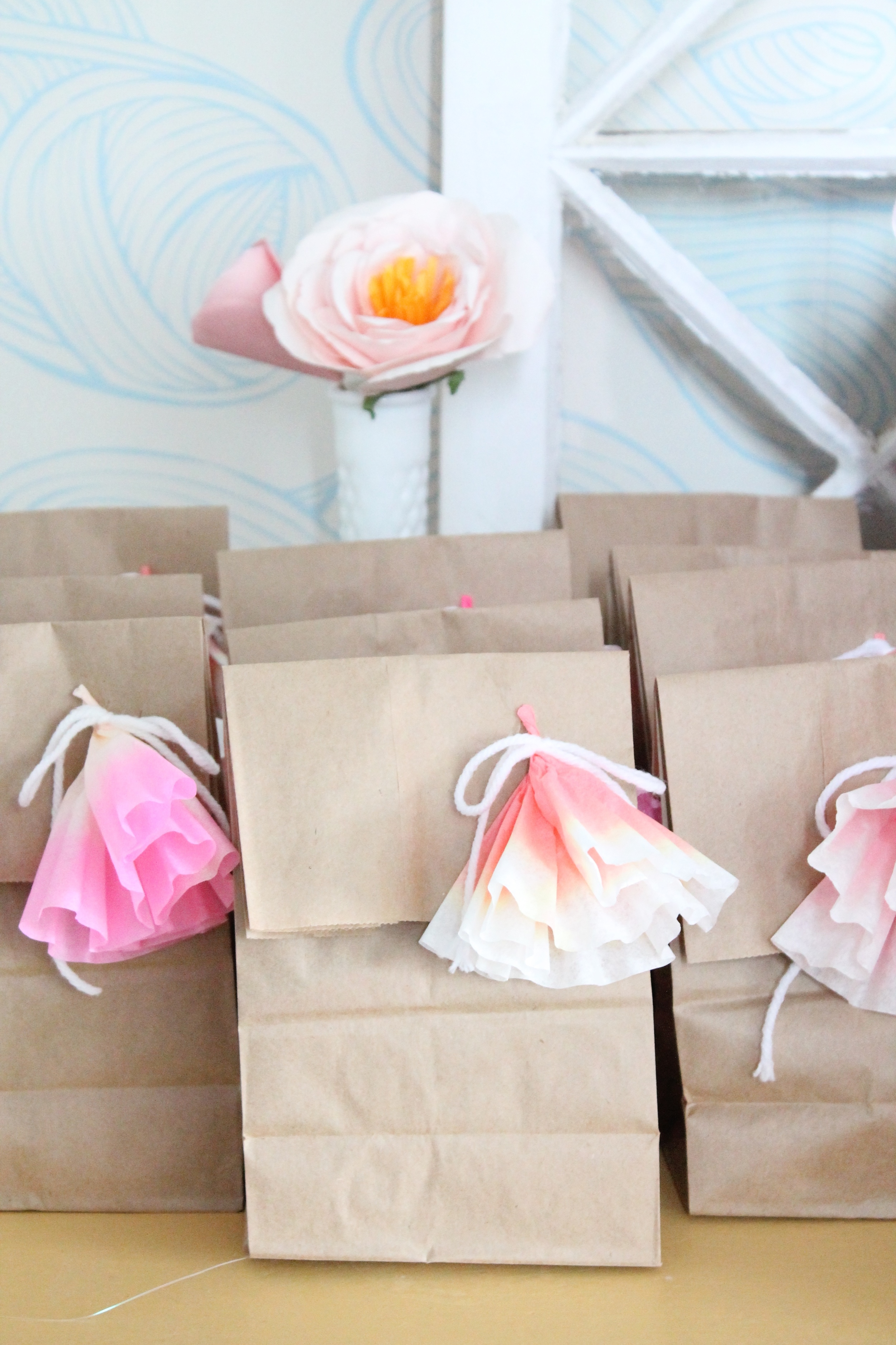 Adorable goodie bag idea for a garden tea party. Made with brown lunch sacks and coffee filter flowers.