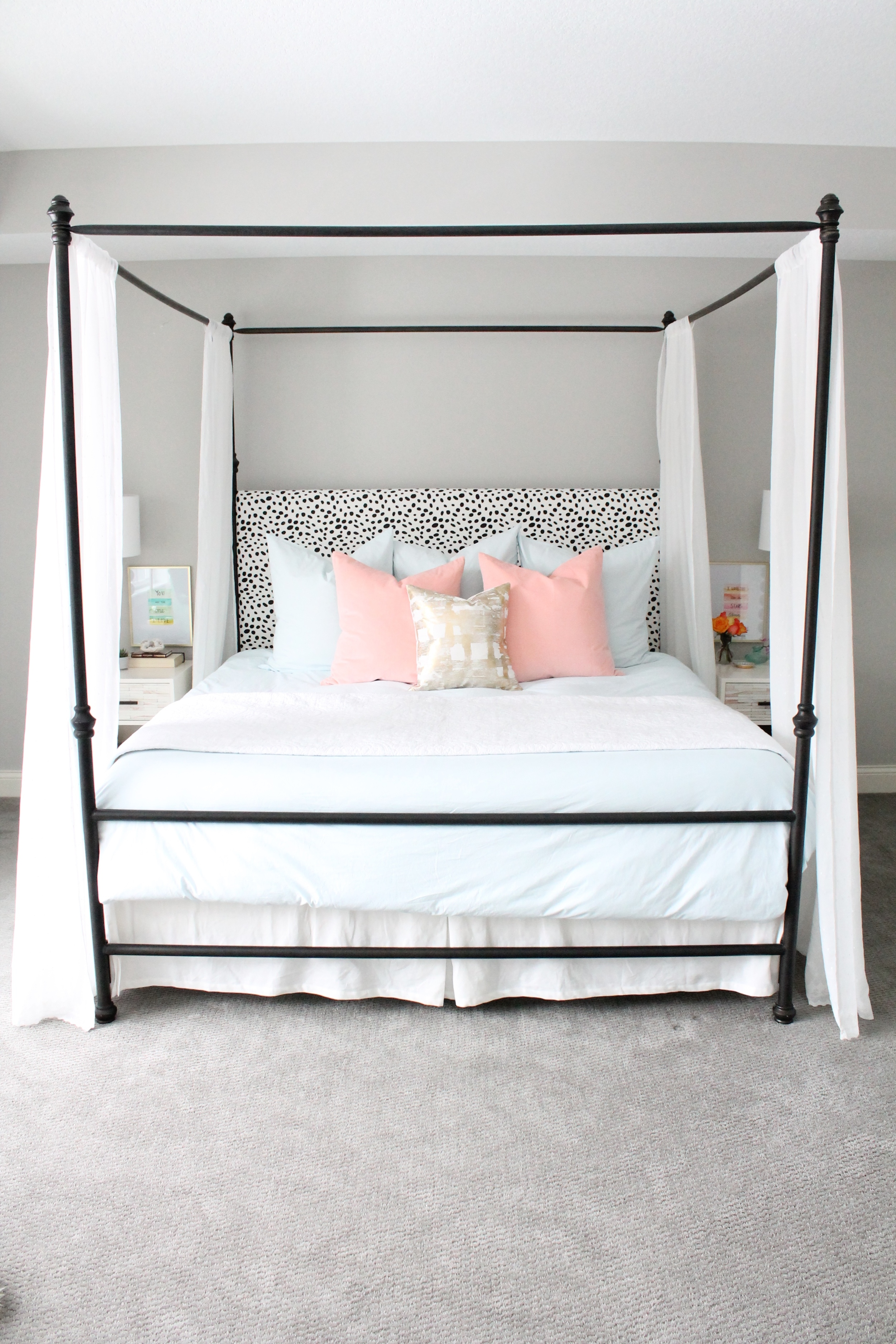 Lovely Master Bedroom. Canopy bed with dalmatian headboard. Pink and blue bedding with a touch of gold.