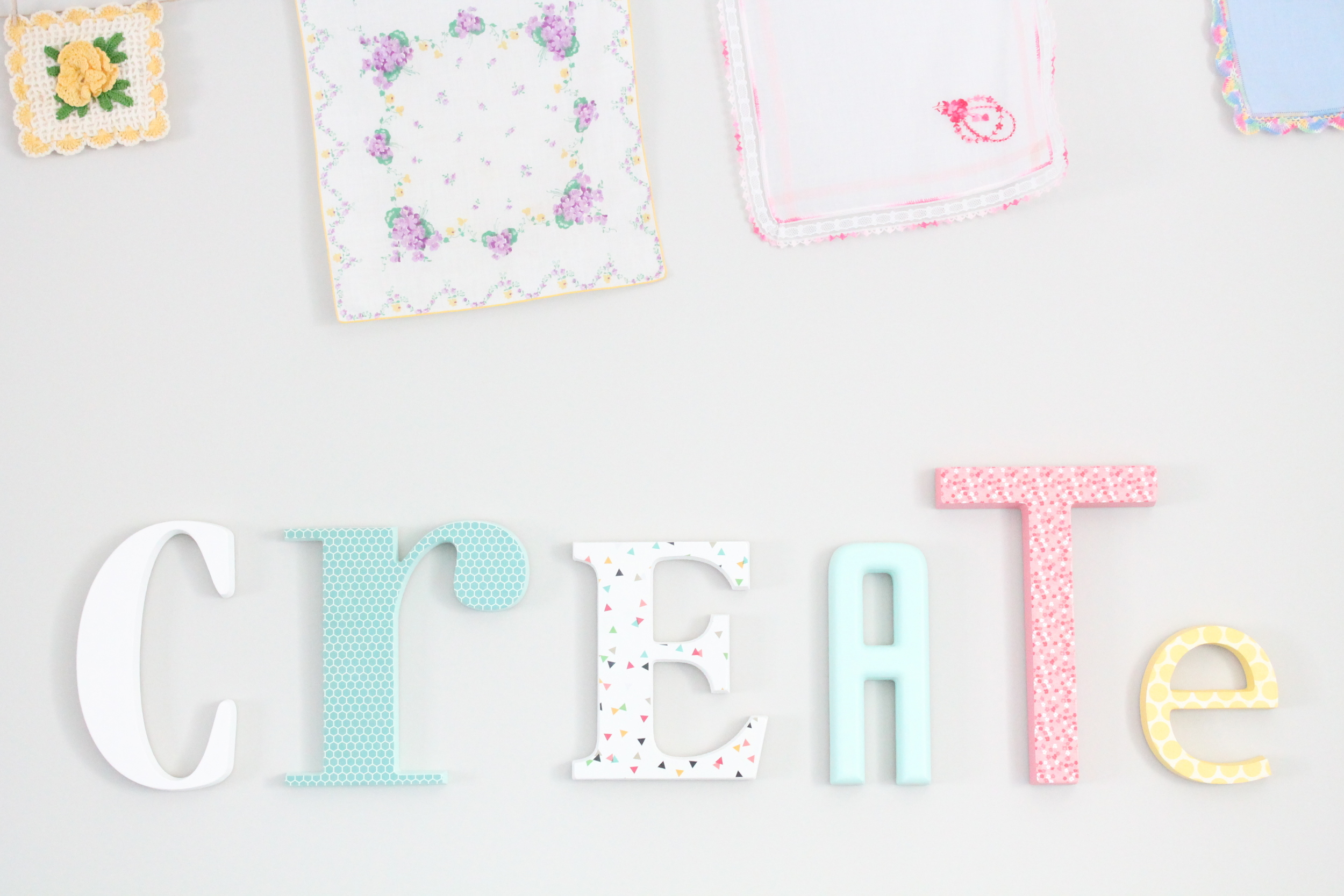 DIY letters for the family craft room. Painted each letter a different color and covered some with scrapbook paper.