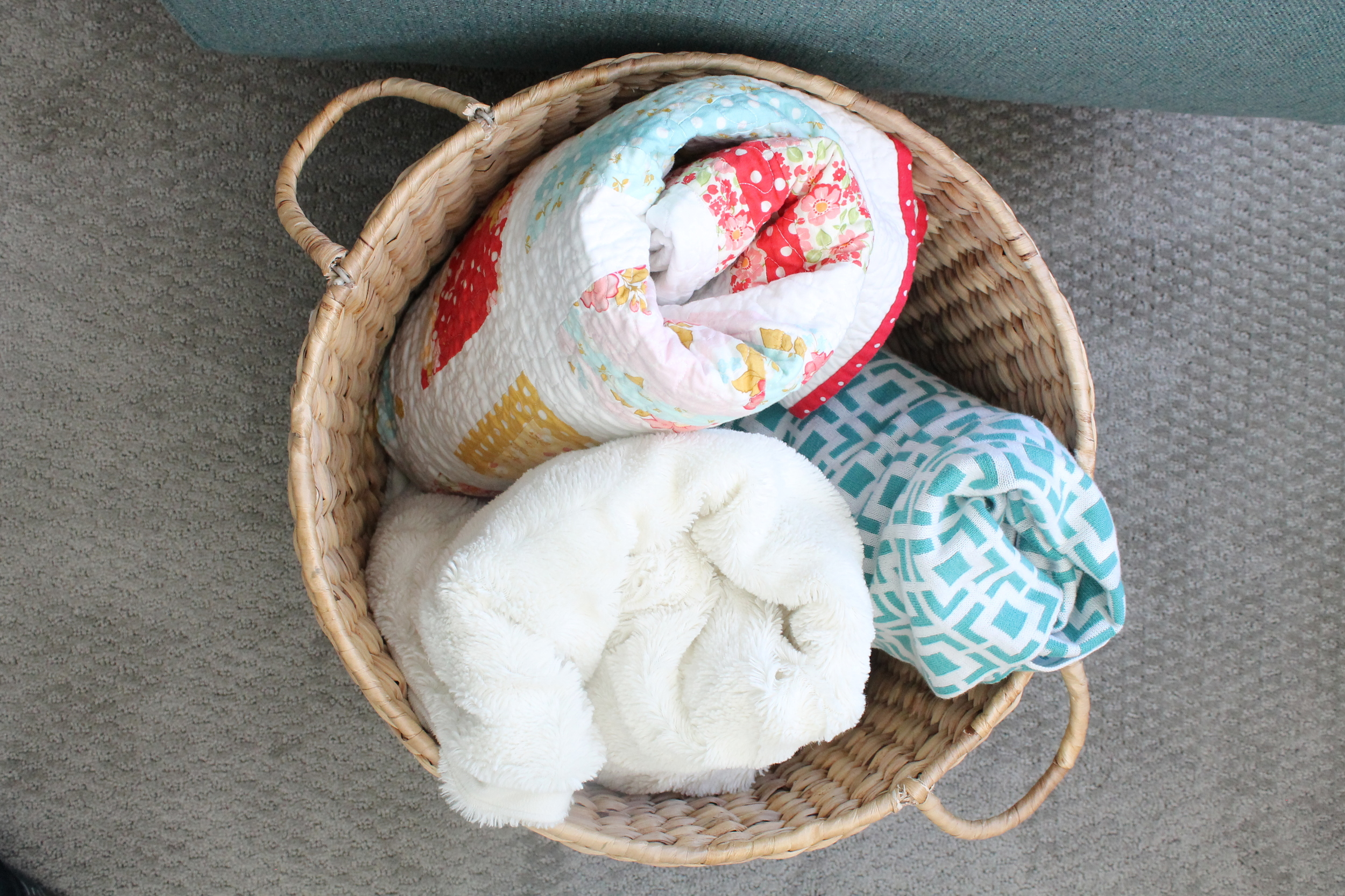 Target basket filled with cozy quilts and blankets.