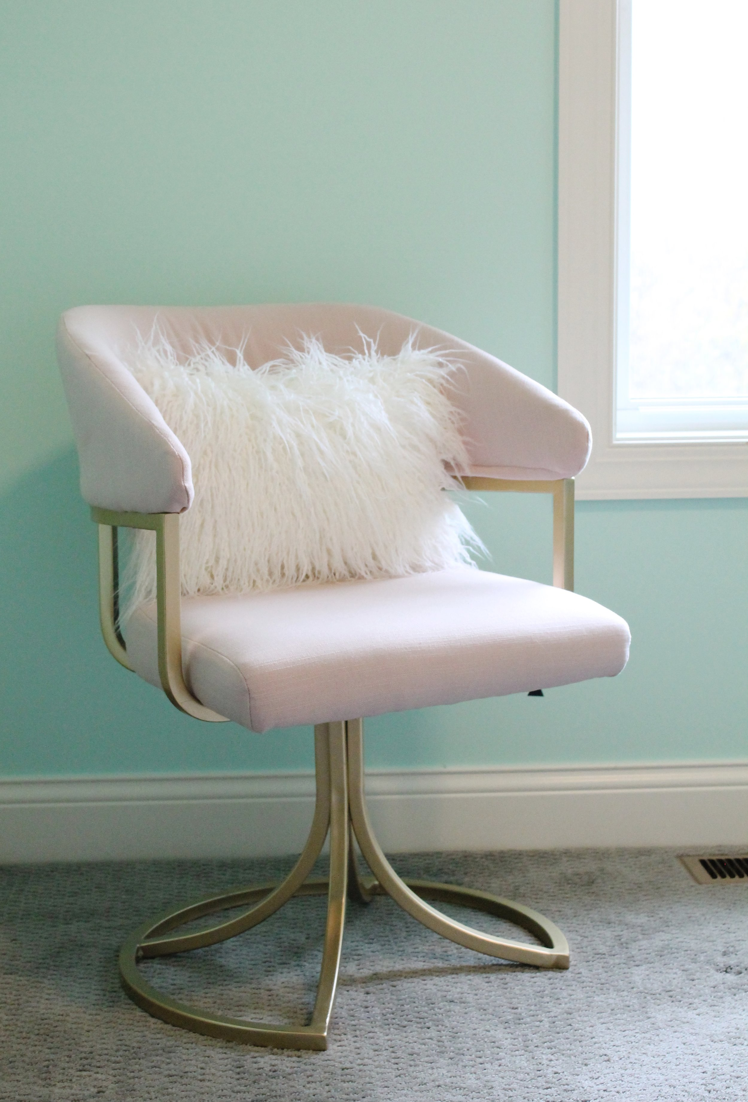 Pink and Gold Chair with mint walls.