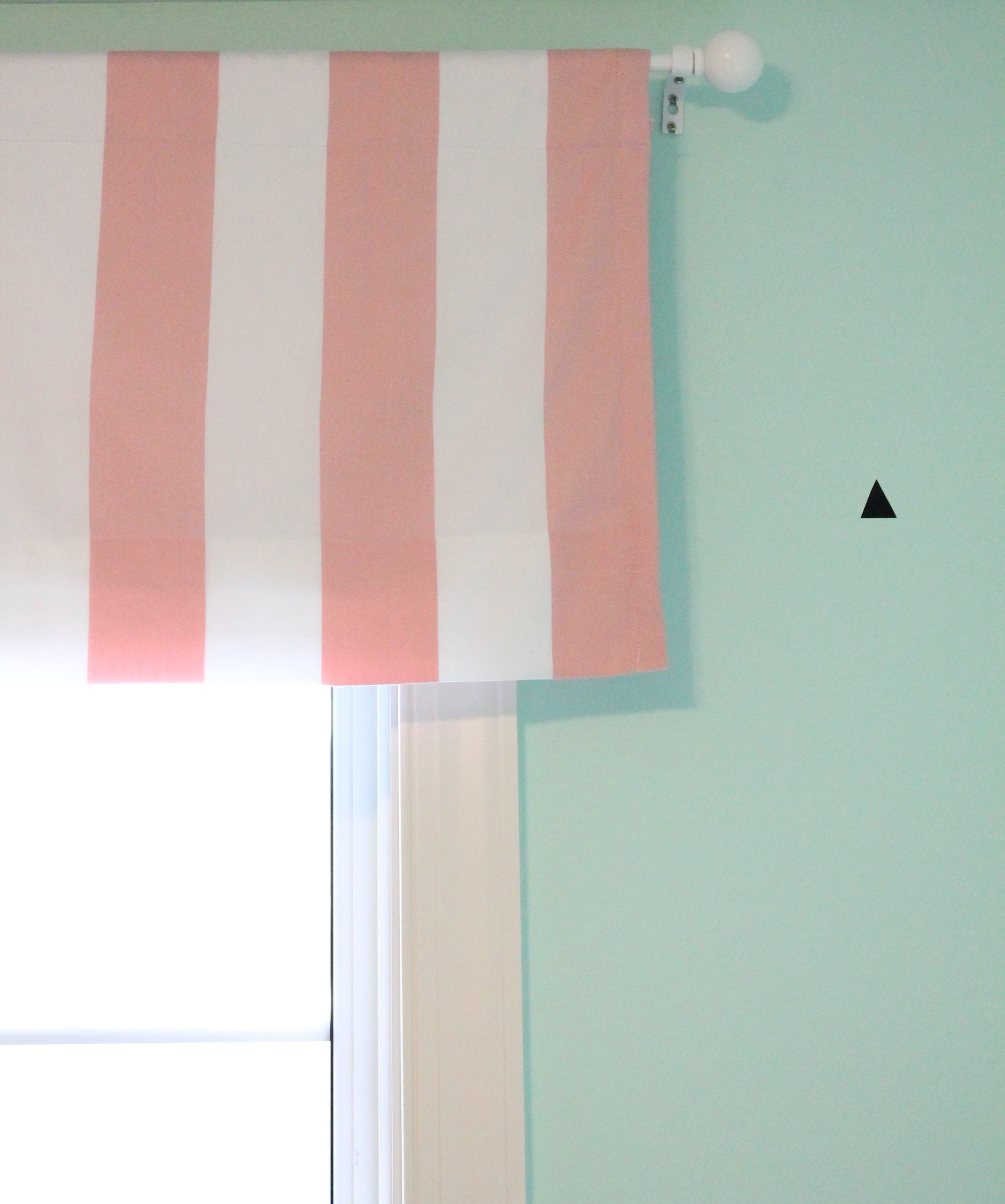 Pink and white striped valance.