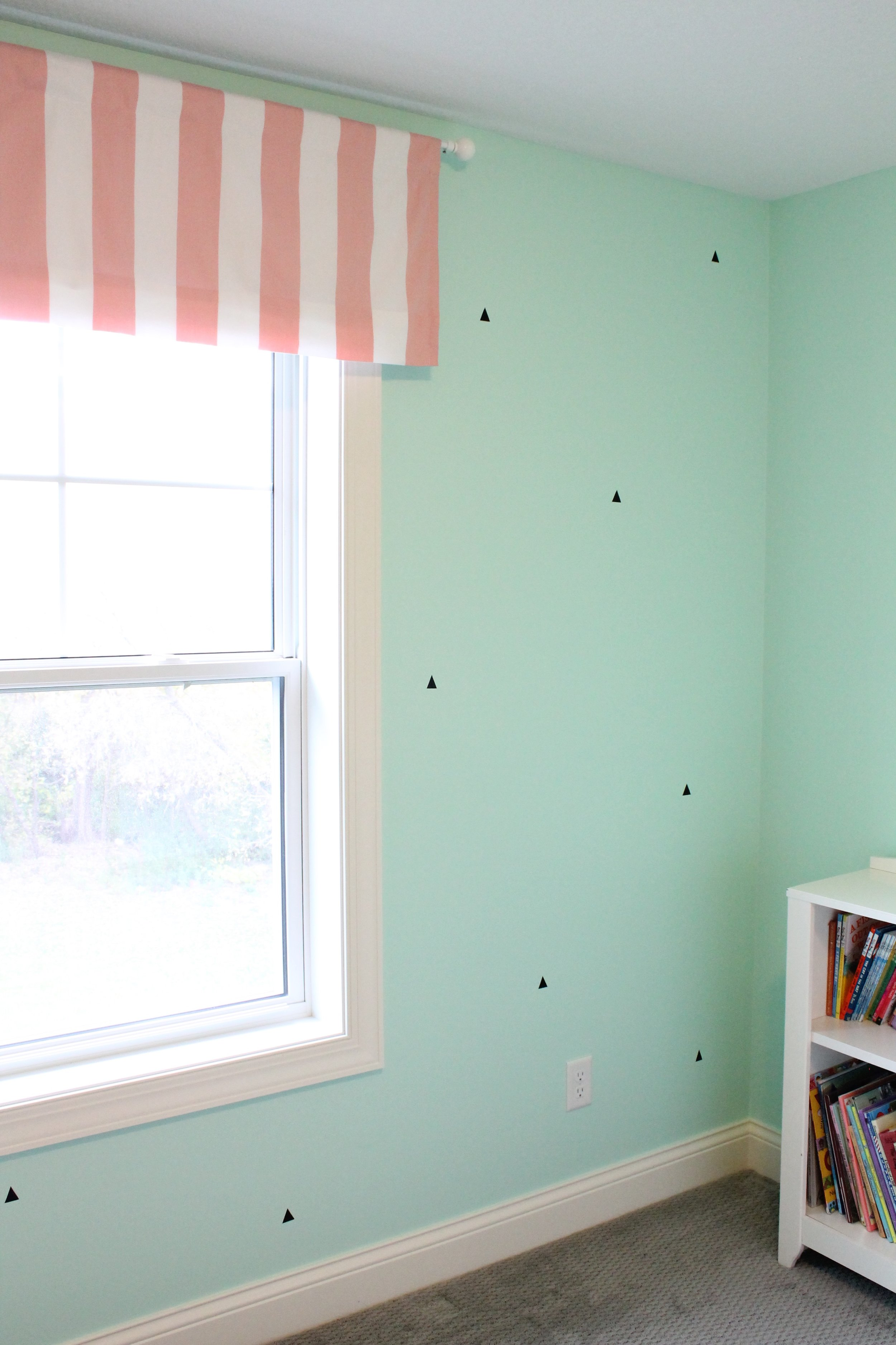 Ice cream inspired bedroom with mint chocolate chip walls.