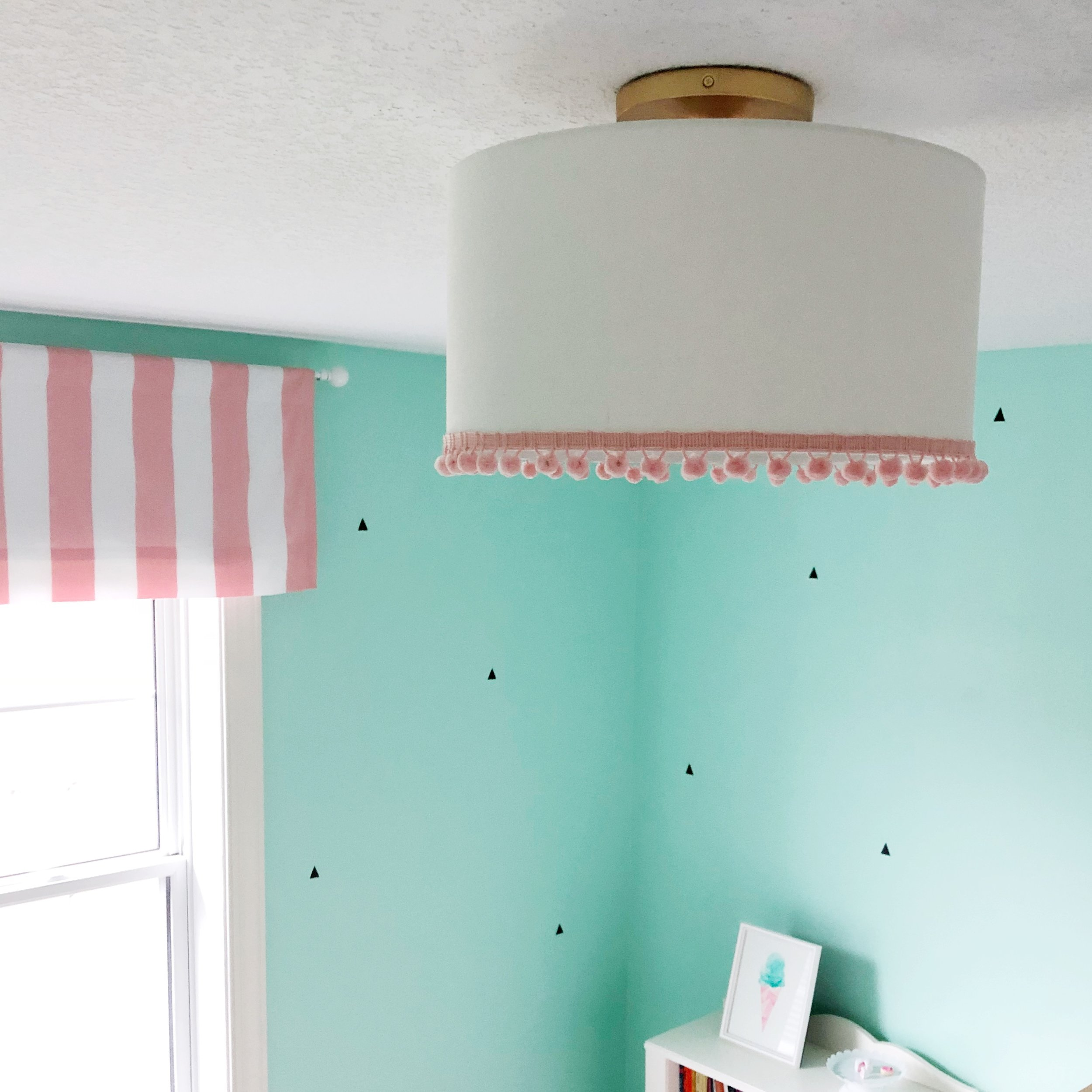 DIY light fixture. Add pom poms to a drum shade from West Elm.