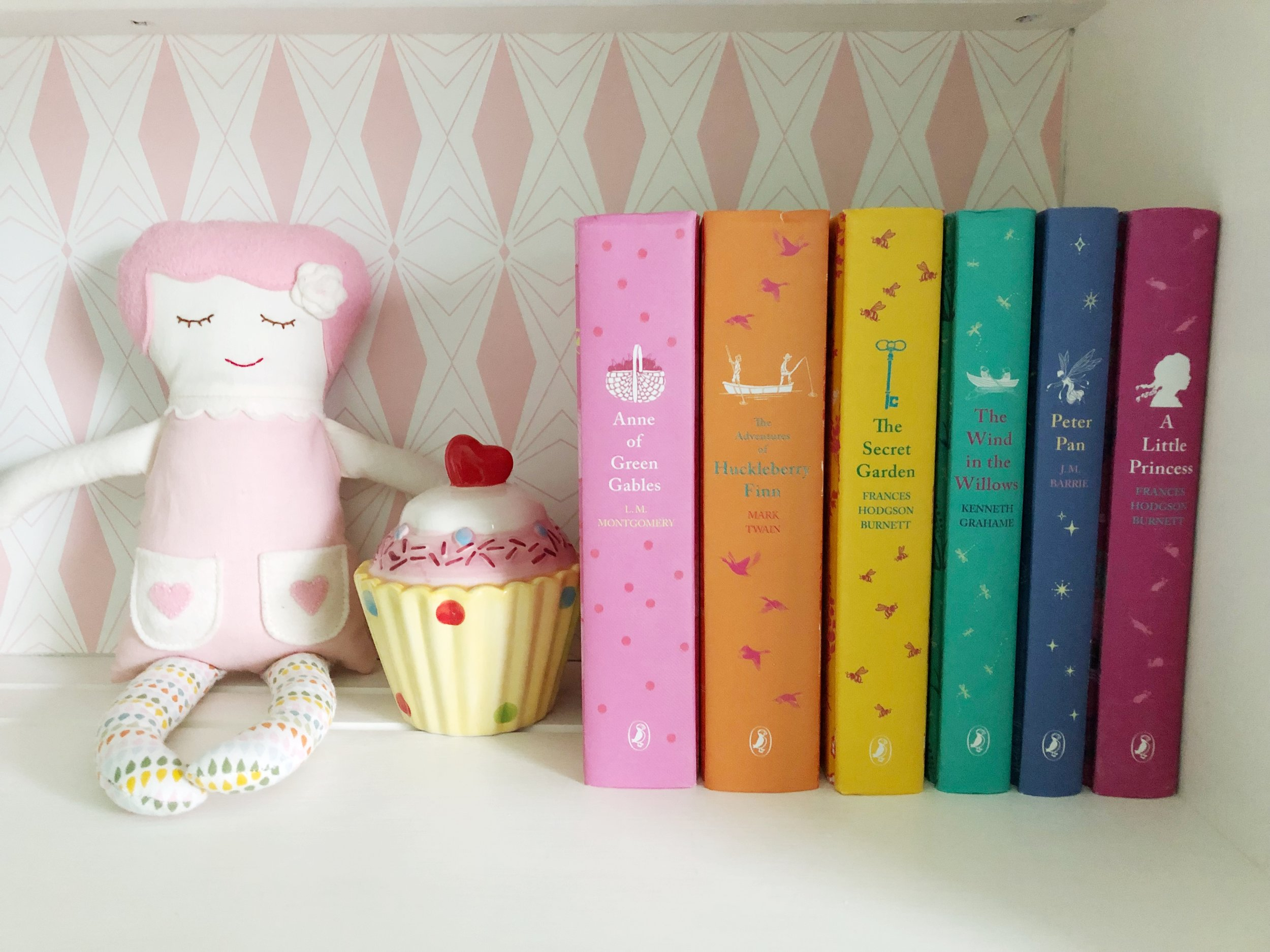 Pretty Books and Black Apple Doll.