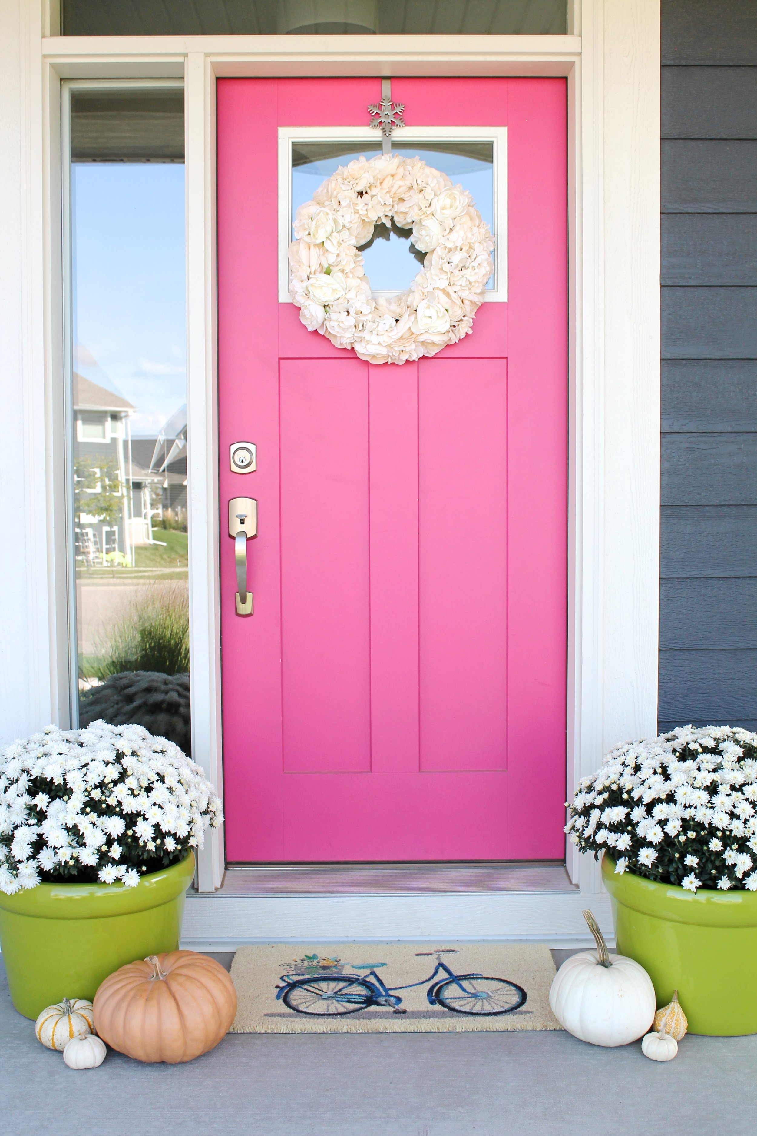 Pink Front Door. Color is Eros Pink by Sherwin Williams.