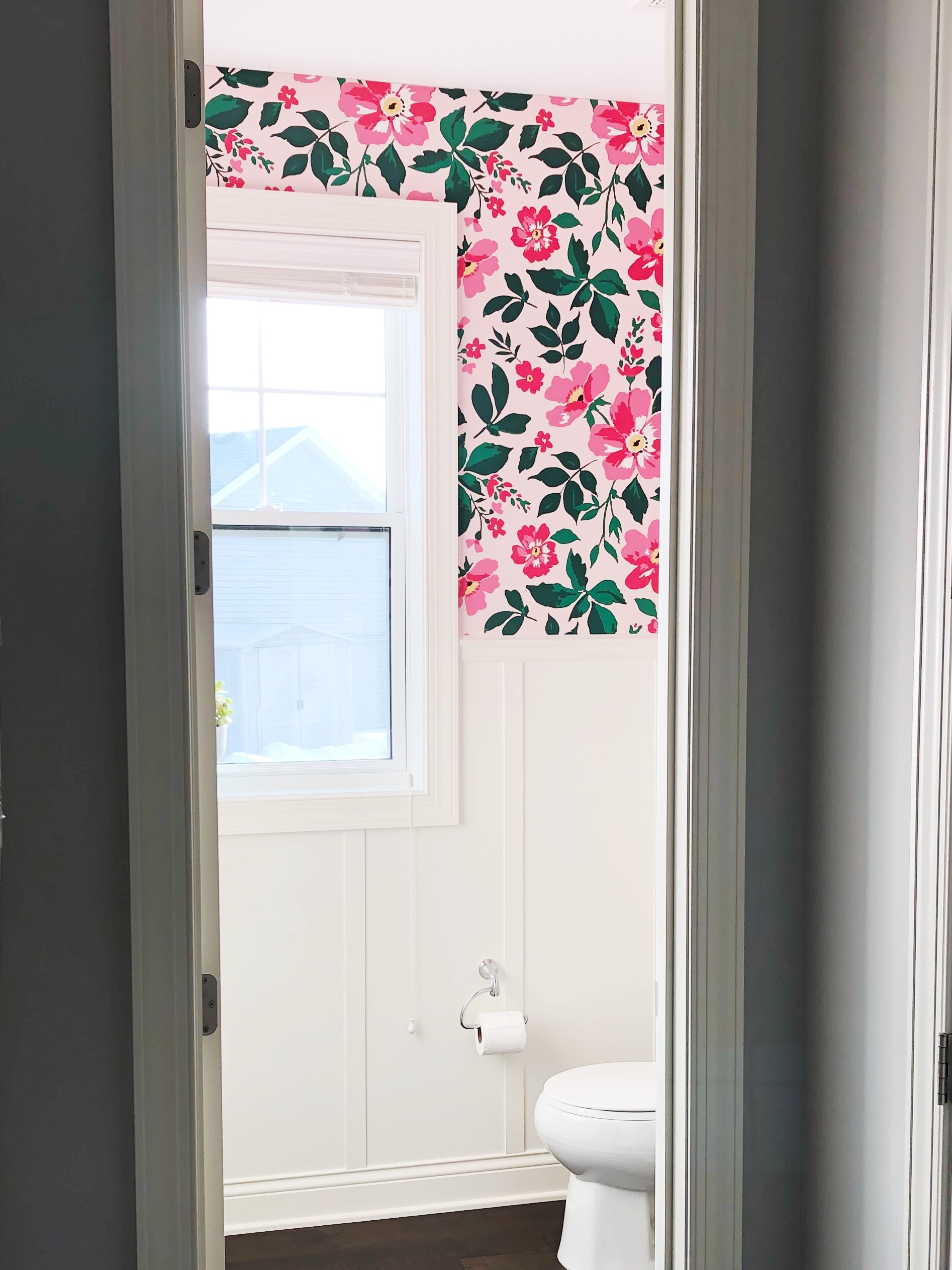 Bathroom makeover with custom wallpaper and DIY Board and Batten. Pink and Green Powder Room.