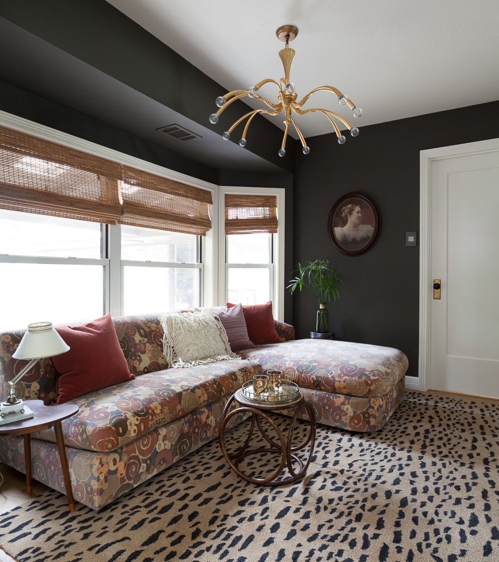 Benjamin Moore Dragons Breath paint with a Jack Larsen sofa and leopard rug. Vintage brass Italian chandelier and bamboo blinds.