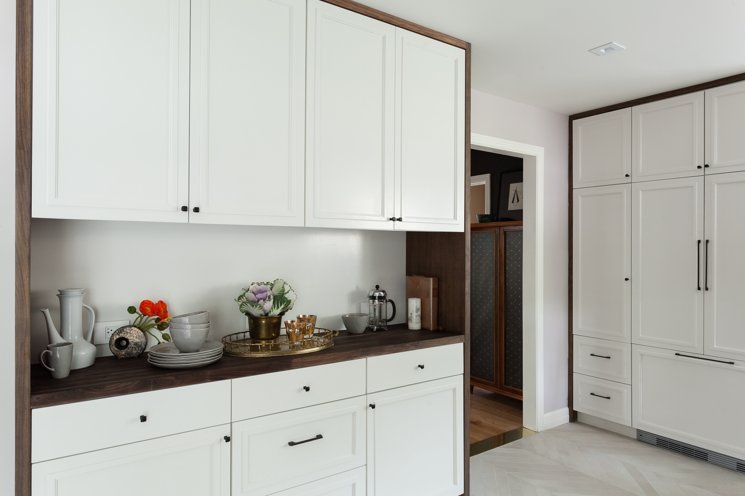 Built in custom hutch with white cabinets in Benjamin Moore Sea Pearl paint and walnut casing.