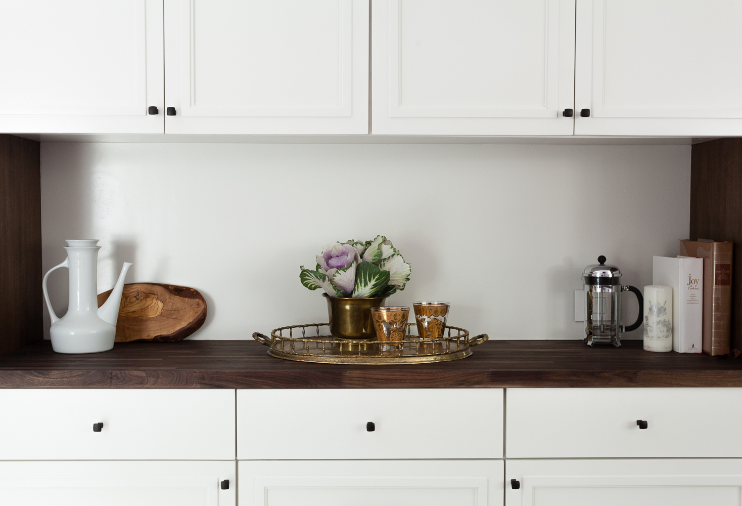 Custom white cabinets and walnut butcherblock counters with hardware by Top Knobs in a sable finish. Built in hutch.