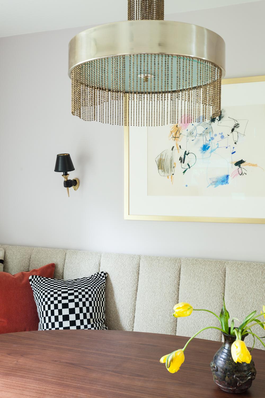 Vintage brass Pierre Cardin fringe chandelier and abstract art by Nancy Lee