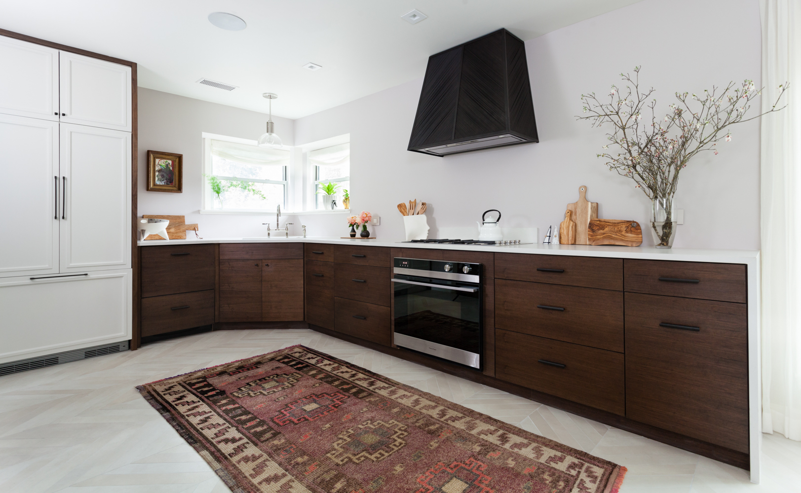 Fisher and Paykel integrated appliances chevron floors and antique turkish rug