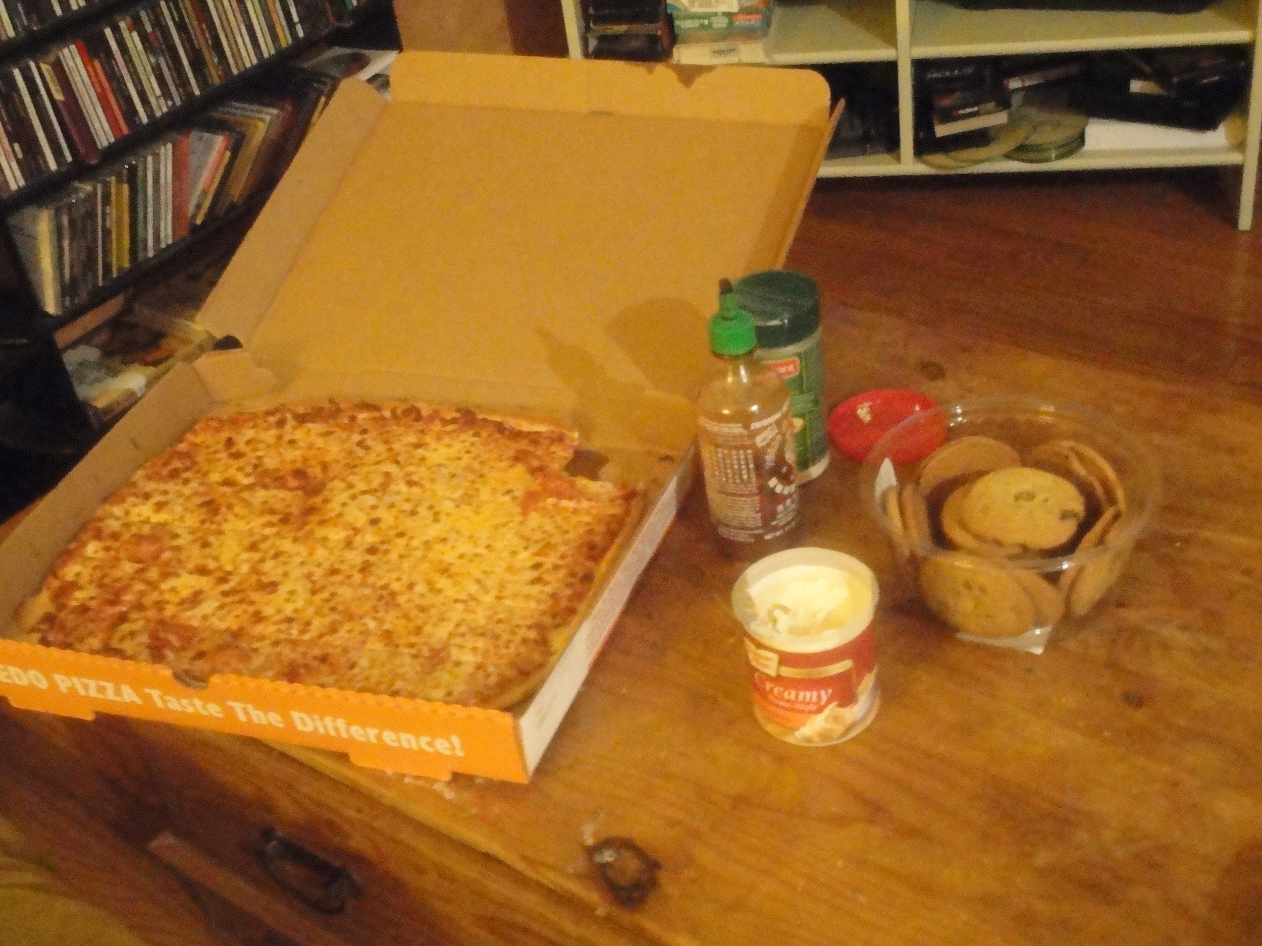 1 extra cheese large Ledo pizza. 1 container of chocolate cookies. I container I vanilla icing.
