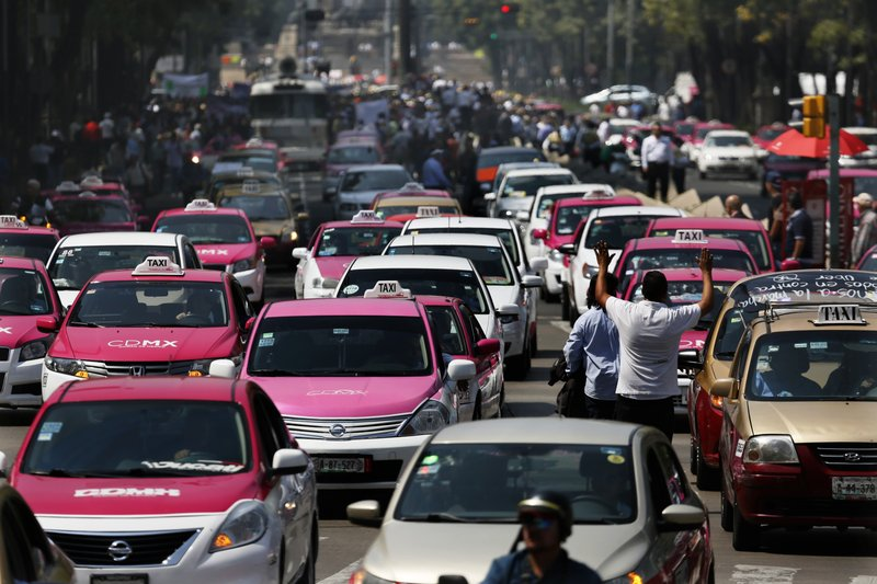 From Google Images: Taxis and Traffic in Mexico City