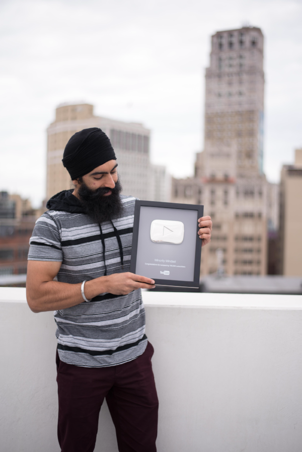 Jaspreet SIngh with the 100,000 Subscriber YouTube Plaque