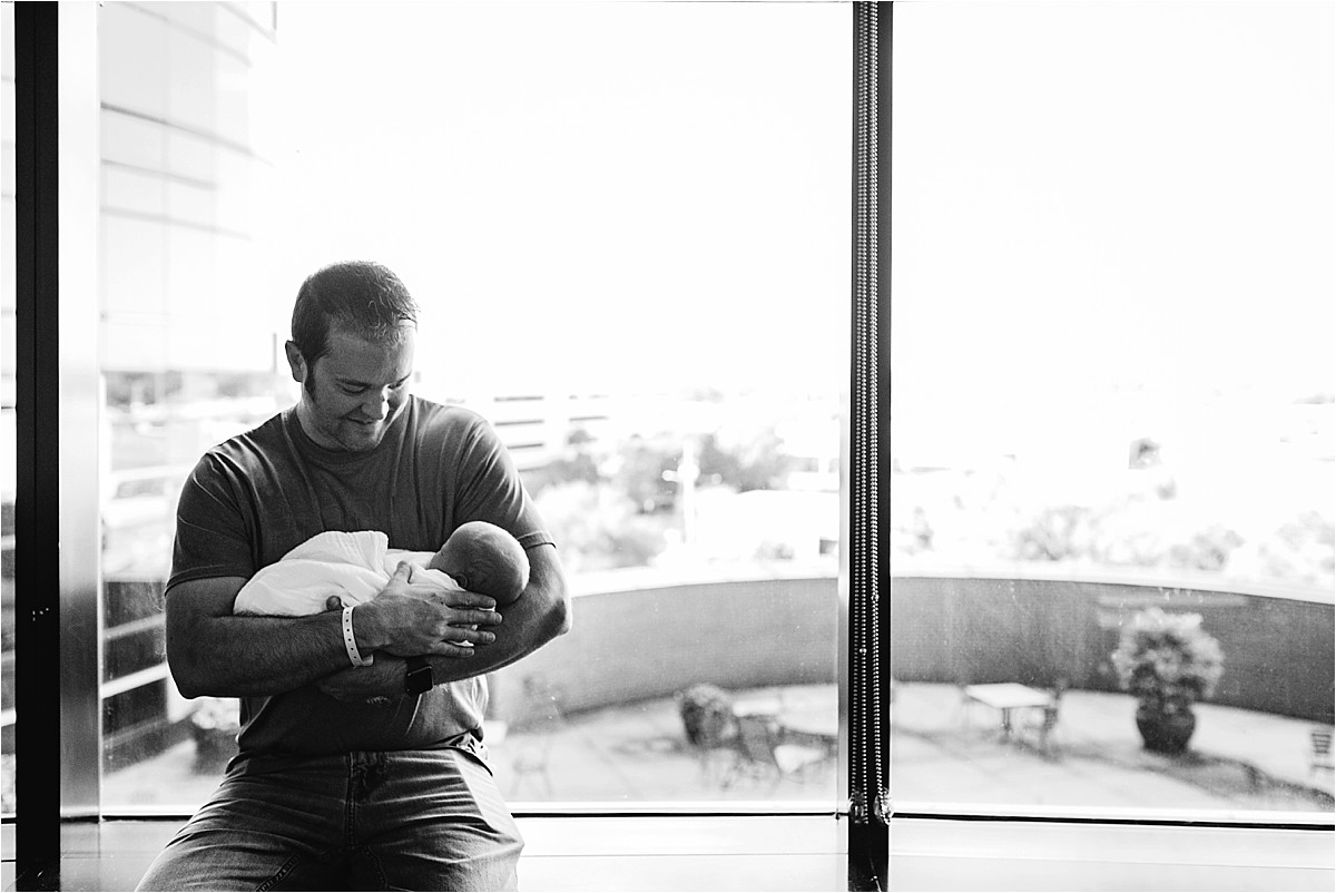 Dad holding baby boy for the first time in hospital   Orlando Fresh 48 Photographer