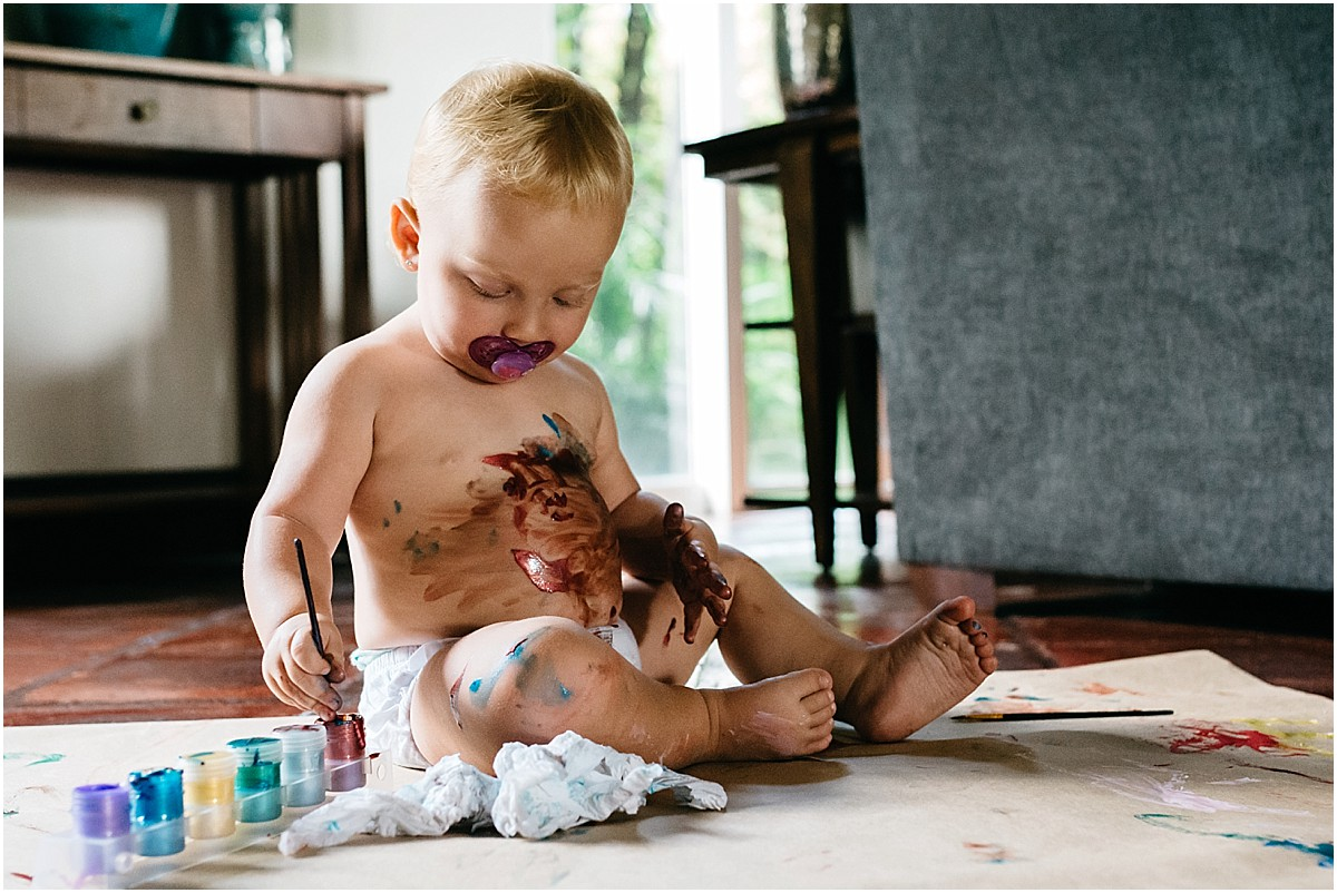 baby painting all over her body in a diaper in Costa Rica house
