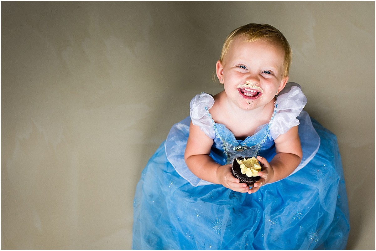 Little girl dressed up as cinderella with a cupcake in Costa Rica home