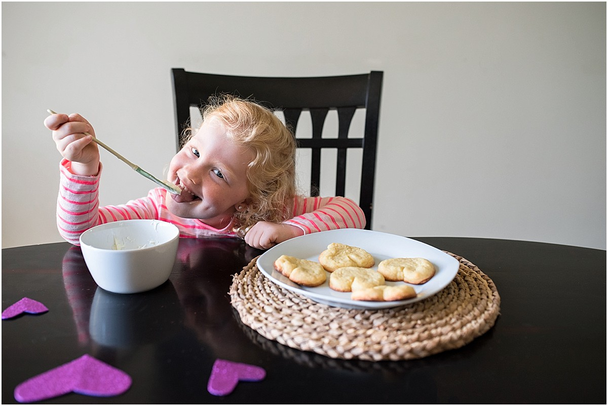 little blonde girl making heart-shaped cookies in her home in Costa Rica