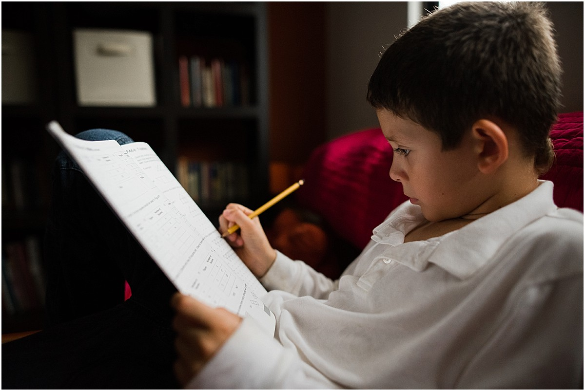 little boy doing math during his documentary photoshoot in his Costa Rica home