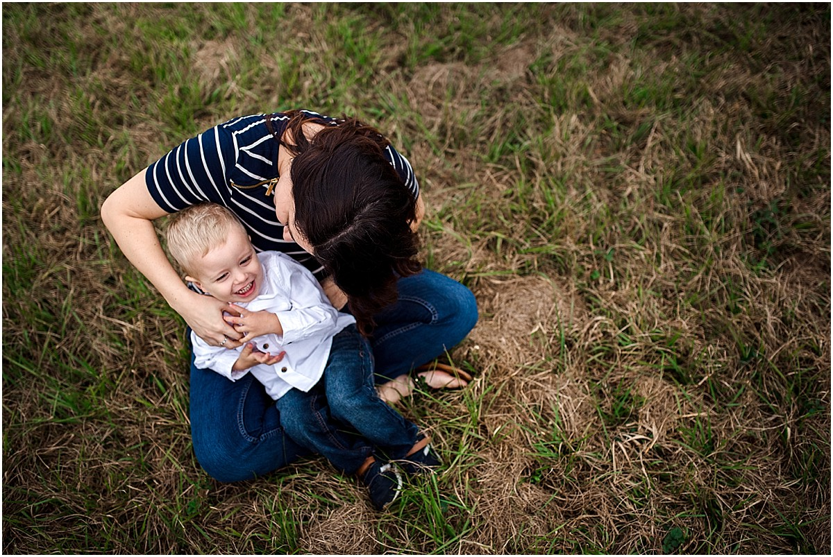Mom tickling her son  | Orlando Family Photographer