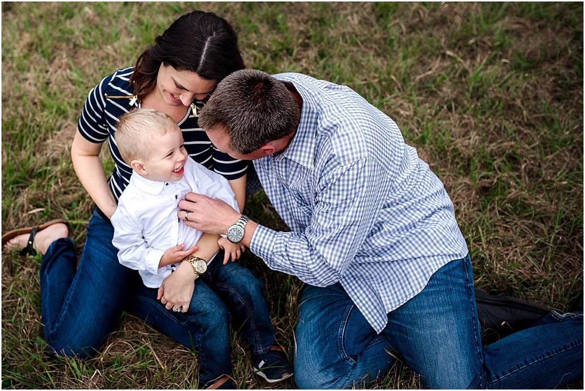 Family tickling each other in a field in Oviedo  | Orlando Lifestyle Photographer