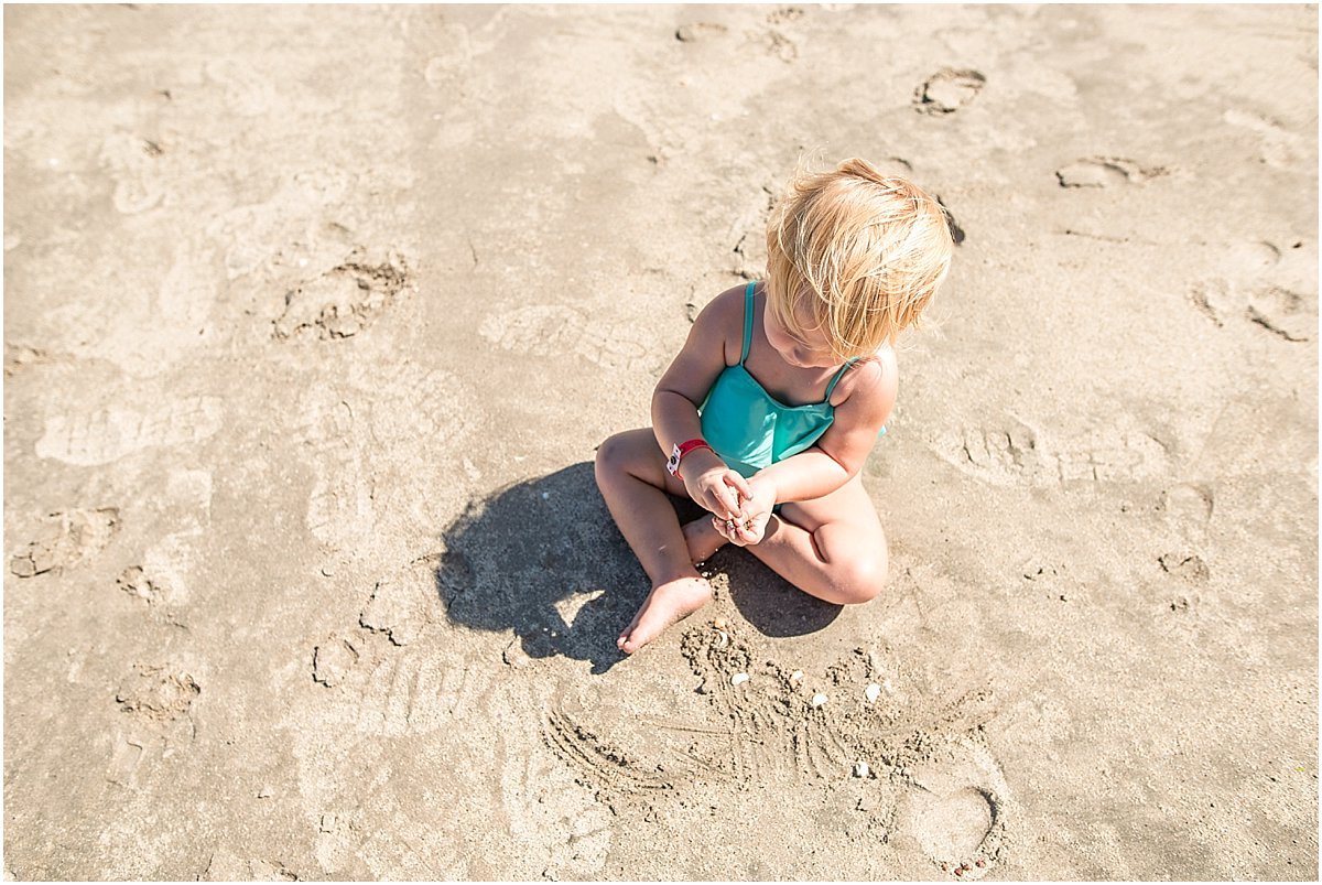 baby playing in the sand in guanacaste