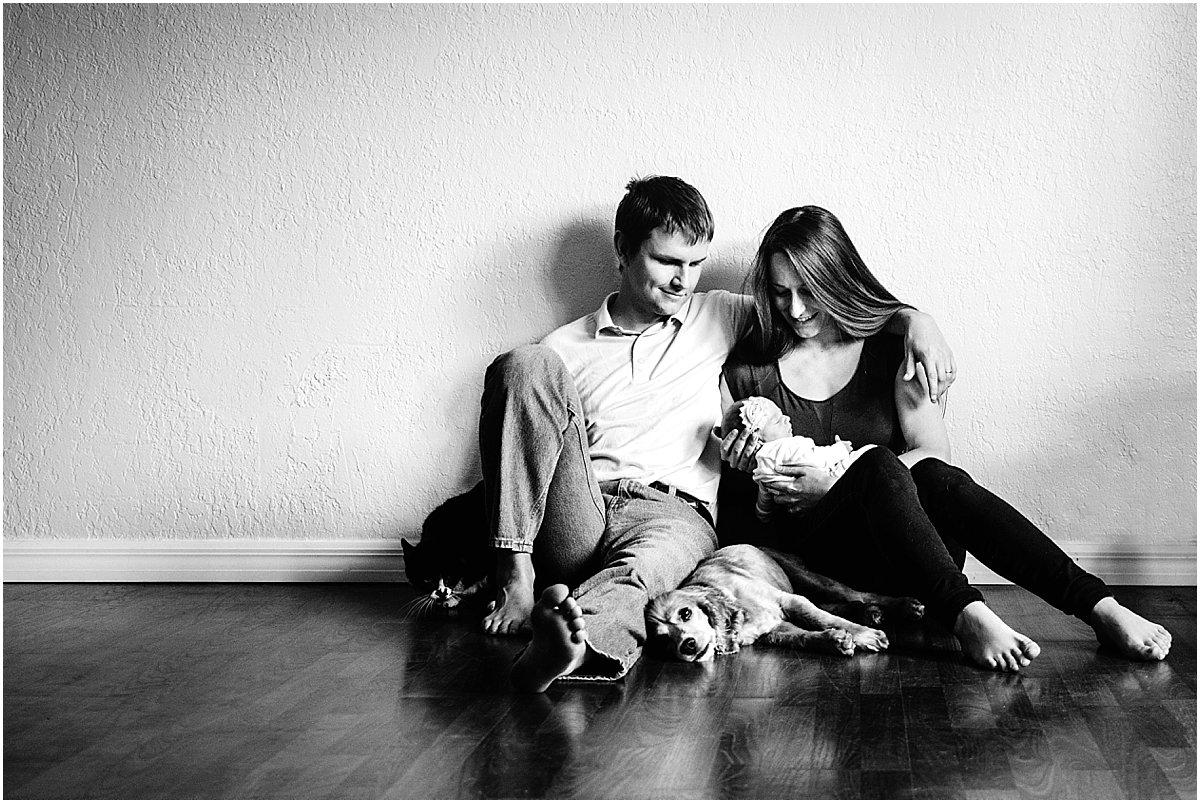 New parents looking at their newborn baby   Orlando lifestyle newborn photographer