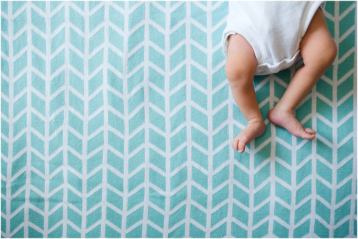 detail shot of newborn baby's legs and feet. Natural newborn photography in central florida