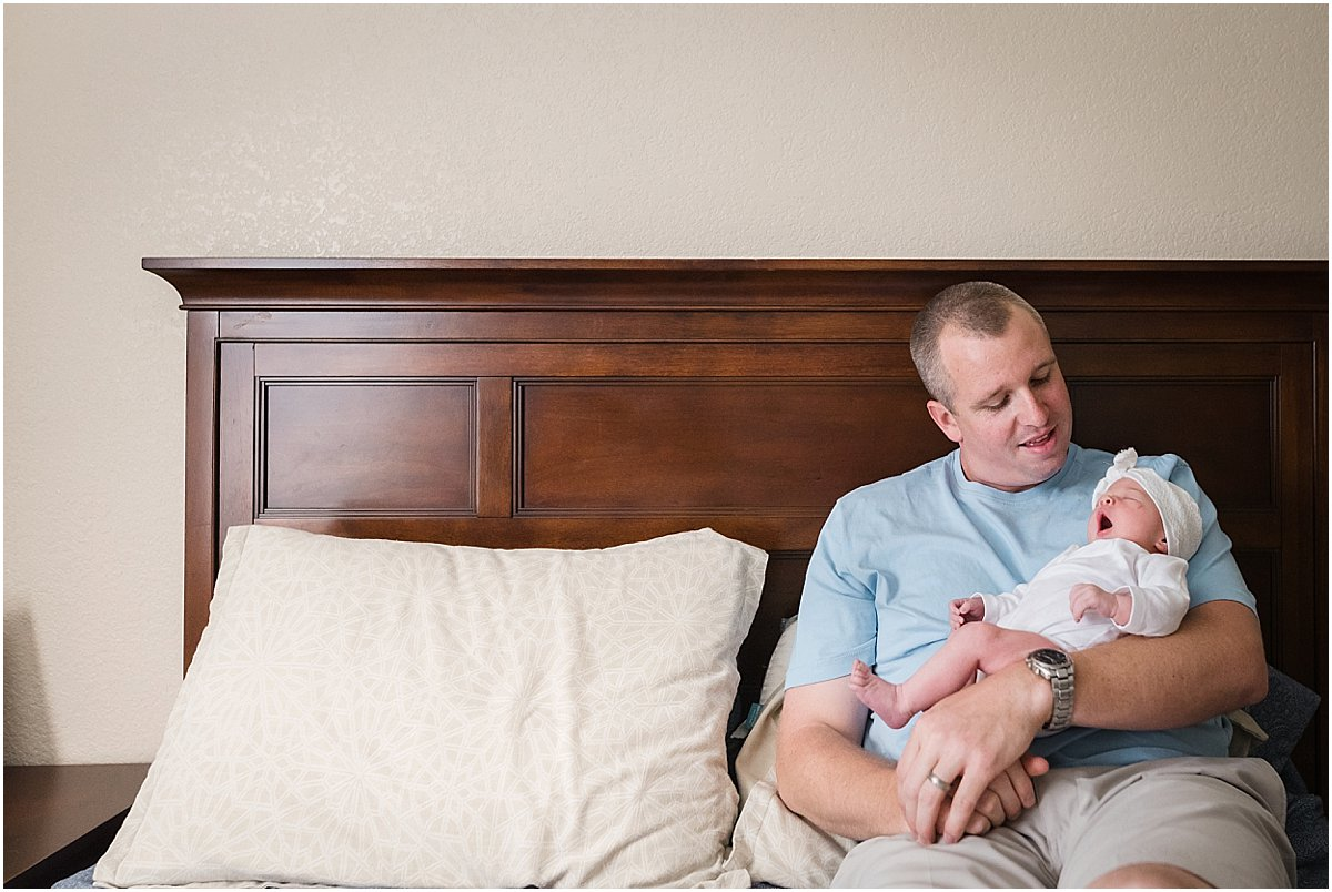 Dad with baby girl yawning | Central Florida Newborn Photographer