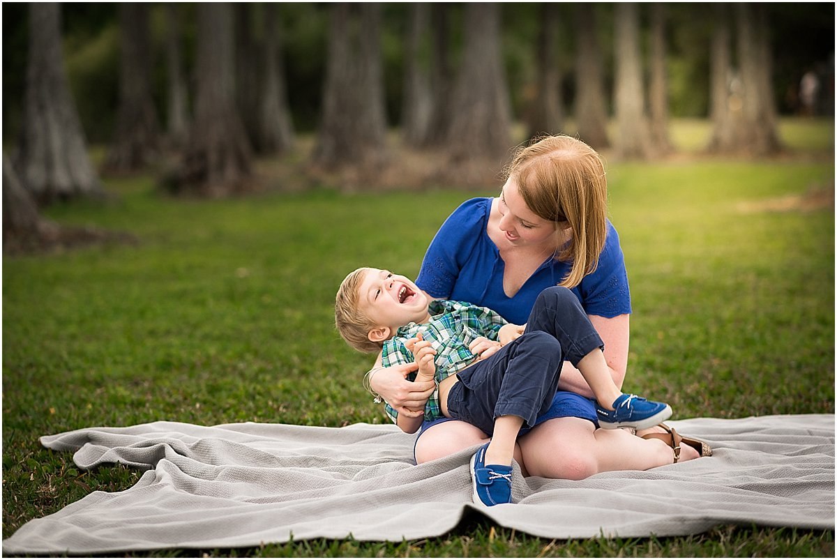 mom and son giggling during family photos