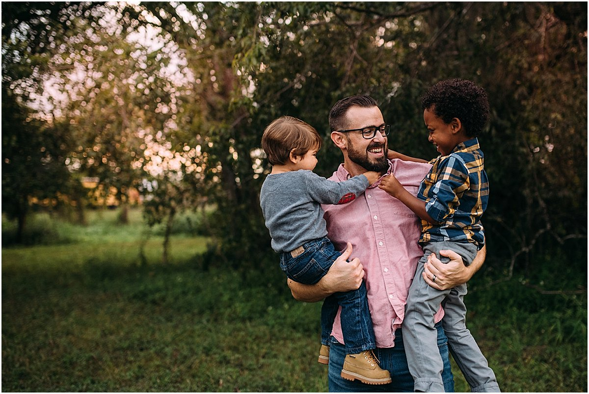 Two little boys hugging their dad | Oviedo Family Photographer