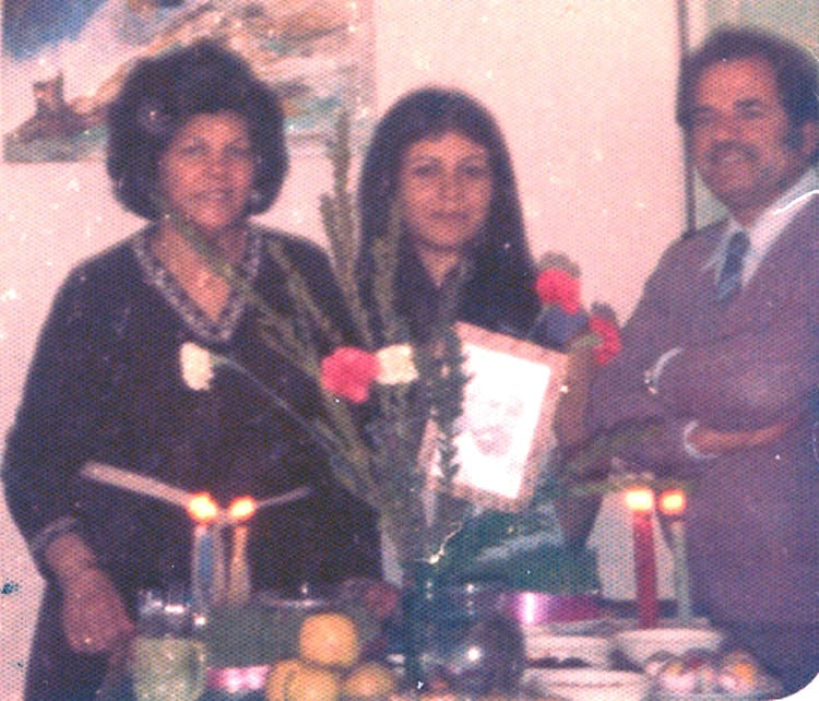 Mona's mother and father (left and right) with Monir R. (center), circa 1980/81.