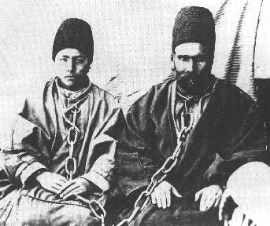 Above, 12-year old Rúhu'llah and his father, Varqá. c. 1896.