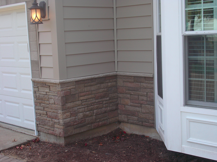 Stone siding at the base of the home.png