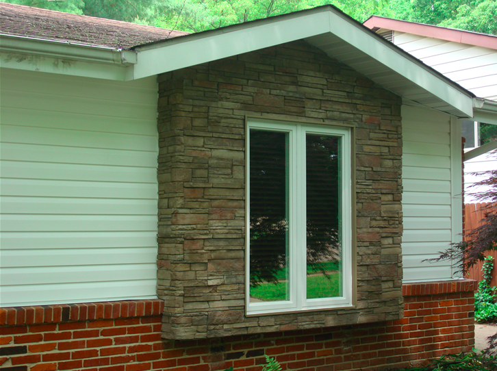 Stone siding for the window with brick siding on the base.png